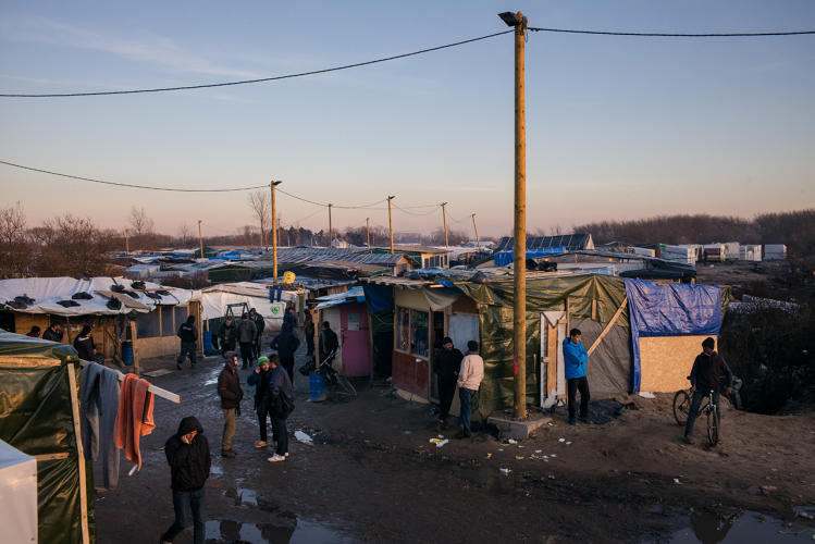 <p>The entrance to the camp in Calais, also known as the Jungle, three miles from the center of town. It has an estimated population of 9,000 refugees.</p>