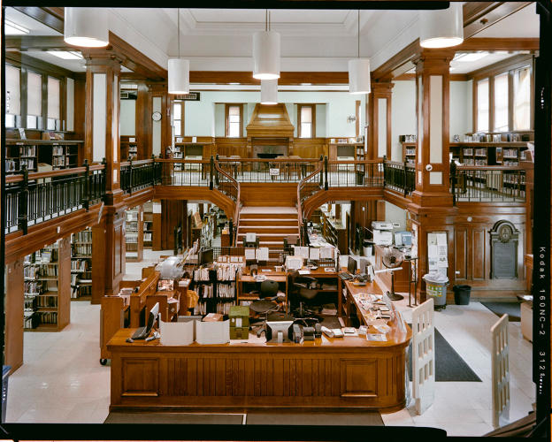 <p>The front desk of the Arlington branch in Brooklyn</p>