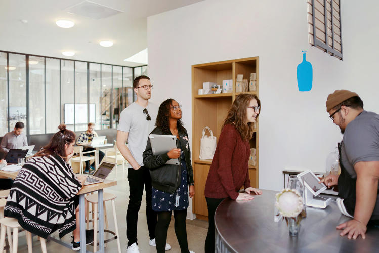 <p>An in-house Blue Bottle Coffee offers espresso, lattes, coffee pastries, and waffles.</p>