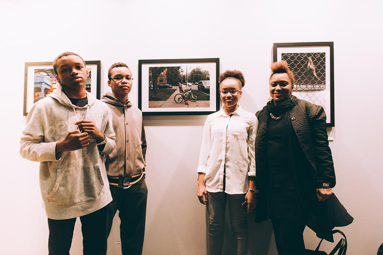 <p>Students pose at the &quot;Views From The Block&quot; exhibit (shot by <em>Street Dreams</em> magazine)</p>