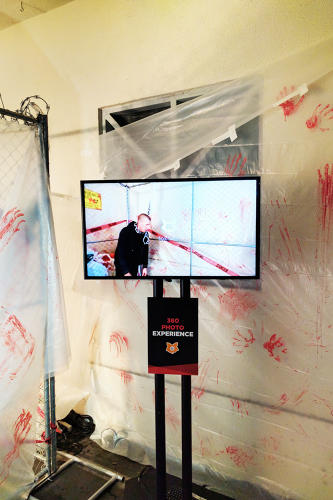 <p>At one photo booth, guests could upload pictures to their Facebook feed of themselves under zombie attack.</p>