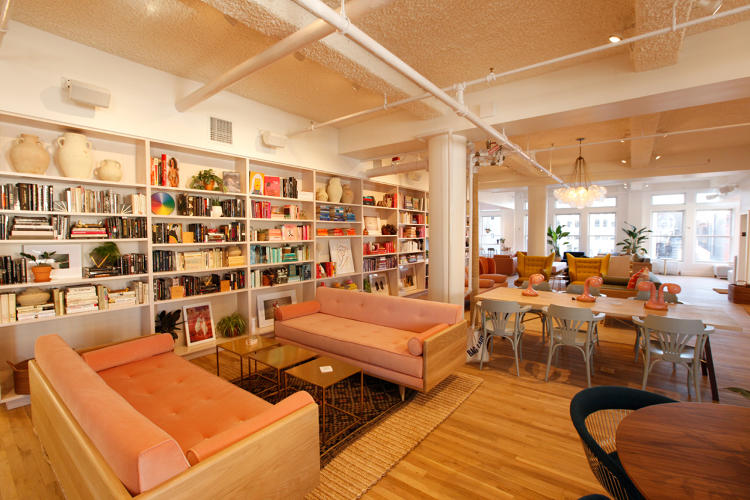 <p>The Wing's open working lounge, which takes about three-quarters of its space, features a 2,000-book library of female writers.</p>