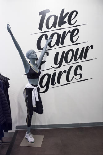 <p>The walls of Bandier's Fifth Avenue store are covered in motivational statements, as well as the company's mission: &quot;Fashion, Fitness, Music.&quot;</p>