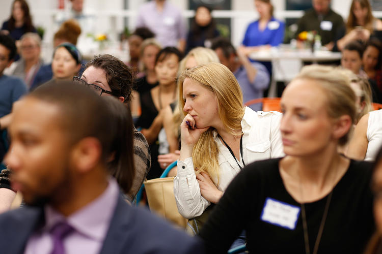 <p>Audience members listen attentively to Policy Genius CEO Jennifer Fitzgerald and WayUp founder Liz Wessel.</p>