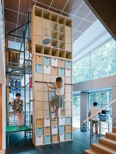 <p><a href=&quot;http://www.ikea.com/us/en/catalog/products/30275861/&quot; target=&quot;_blank&quot;>Kallax shelf units</a> are stacked and bolted together to become a wall of storage.</p>