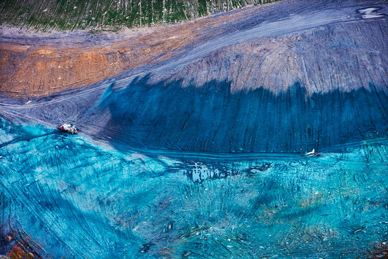 <p>10/28/2005<br /> Hydro-seeding. Grass being planted on a covered mountaintop removal mining site around Kayford Mountain, West Virginia. The forested mountains, valleys, and streams that once stood here are now buried beneath the overburden from mountaintop removal coal mining. It is leveled and then sprayed with a mixture of grass seed and fertilizer. This satisfies the EPA regulations on mitigation. Credit: SouthWings</p>